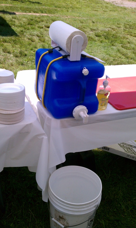 DIY hand washing station made out of a laundry detergent bottle - what a great camping hack!