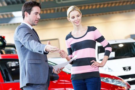 woman-buying-car-at-dealership-horiz