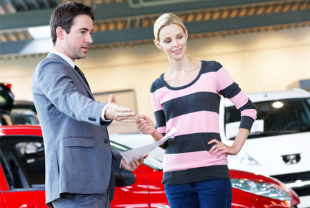 woman-buying-car-at-dealership-horiz