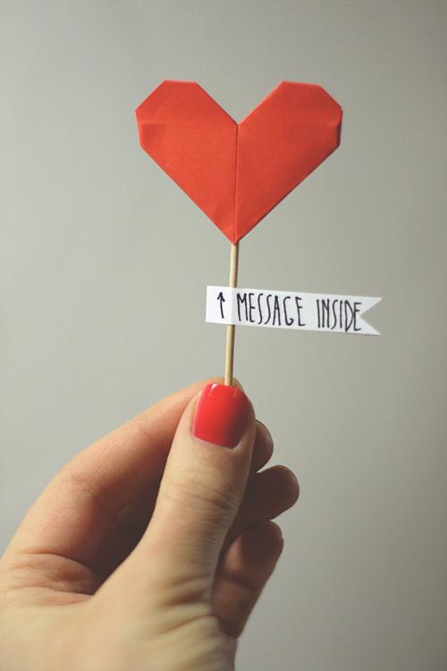 Paper heart in hand