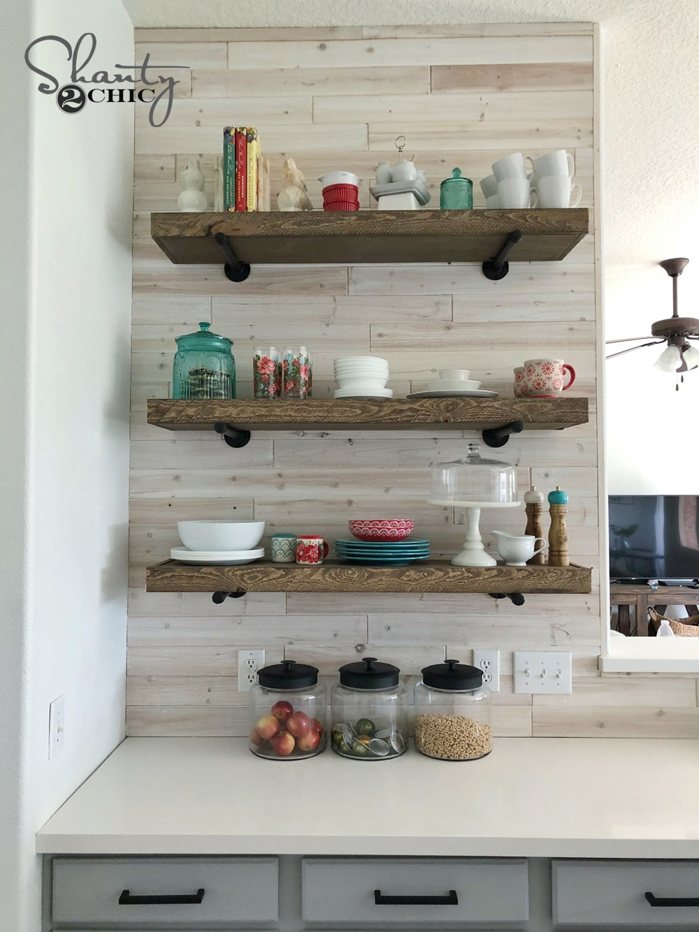 DIY-Floating-Shelves-with-Pipe-Brackets